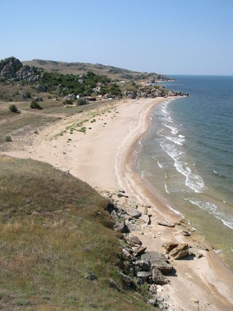 Paradise beach. Sandy beach of Sea of Azov in Crimea. Holiday camp on the uninhabited seaboard.
