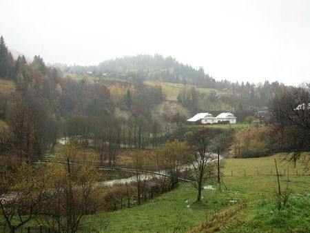Rural landscape. Village in the East Carpathian Mts. Foggy day in the mountainous village.