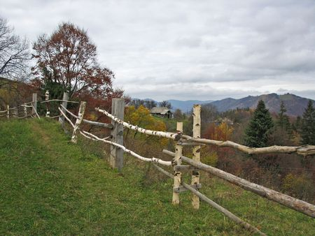 Rural fence. Farmstead in the East Carpathian Mts. Autumnal landscape. Stock Photo