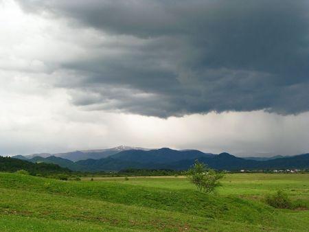 Thunderstorm. First spring thunderstorm. Dark cloud-drift over Carpathian's valley.  Stock Photo