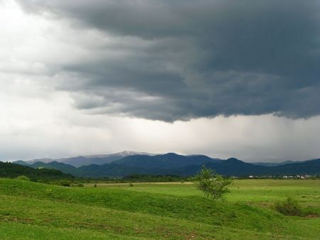 Thunderstorm. First spring thunderstorm. Dark cloud-drift over Carpathian�s valley.  Stock Photo - 6536808
