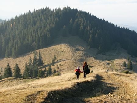 Autumnal family travel. Travel in the Carpathian Mts. Mother and daughter in the open country.  Stock Photo