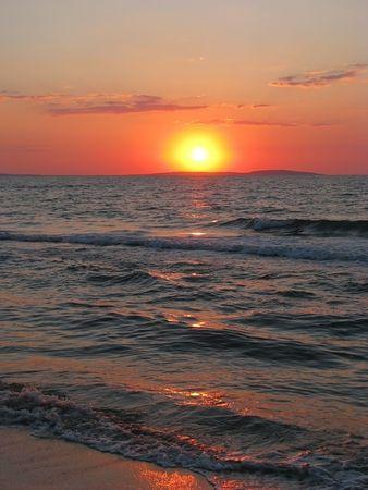 Cloudless sunset. Summer sundown on the Sea of Azov.