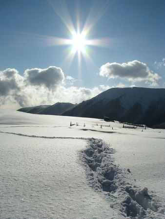 Beautiful winter day. Sunny day in the Carpathian Mts. Footprints in the snowbound mountains photo