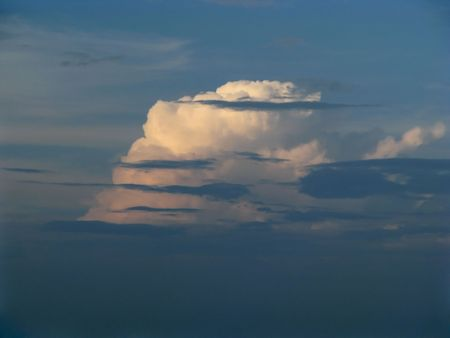 Cloud-drift. Cumulus clod in the evening. Sunny cloud in the twilight.  Stock Photo