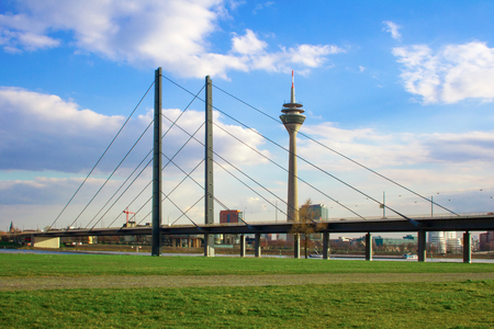 Low angle view of Rhine knee bridge and Rhine tower against sky