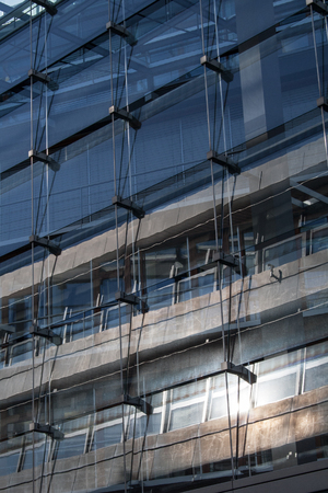 Gray metal and glass facade of an office building