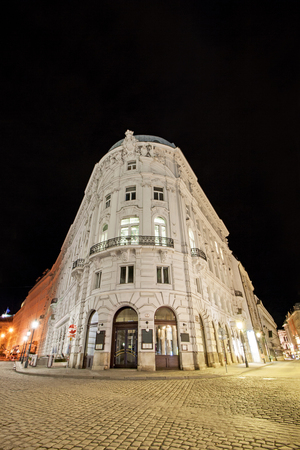Low angle view of historic illuminated building at Vienna, Austria