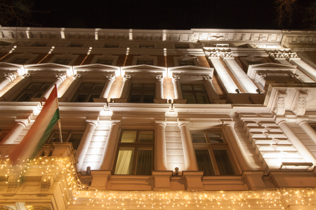 Festively illuminated building on the Andrassy Utca in Budapest at the center of Hungary, Europe