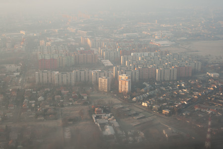 Aerial view - skyscrapers in Szolnok seen from the plane landing on Budapest, birds-eye view