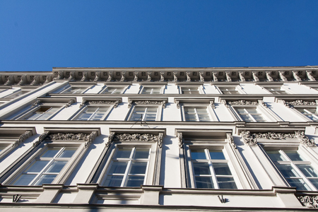 Historic residential building with white facade in the center of Hungary