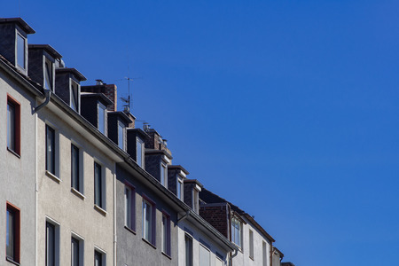 A whole row of attic apartments and blue sky in Dusseldorf Banco de Imagens - 110038405