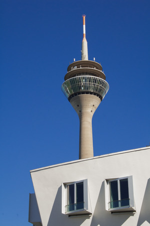 TV tower in Dusseldorf in front of the blue sky and a modern building