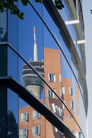 Modern office buildings in Dusseldorf: reflection in a glass facade