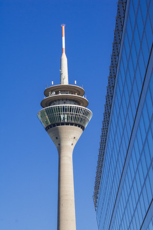 TV tower in Dusseldorf in front of blue sky and a modern building