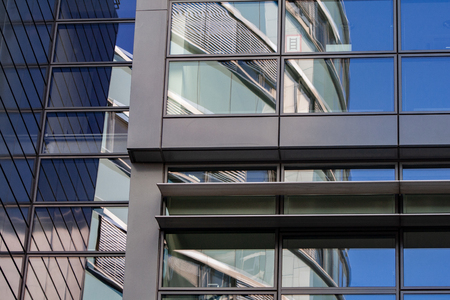 Reflections in the shiny glass facade of a modern building in Dusseldorf Banco de Imagens