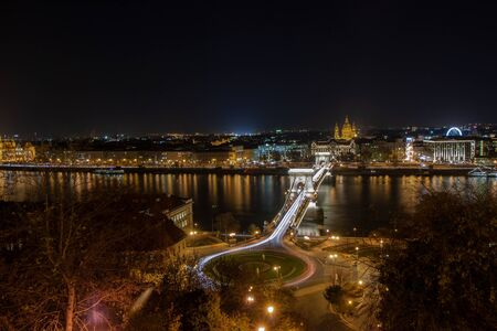 Budapest, the capital of Hungary - Adam Clark Ter (Square) and Chain Bridge, in the background St. Stephen's Church (St. Istvan Templom)