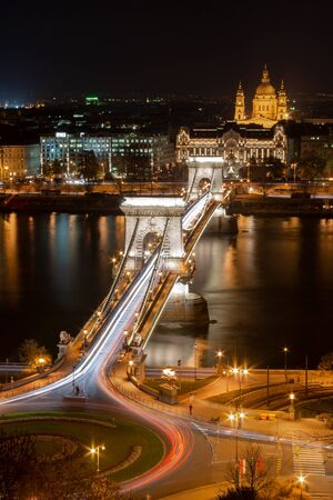 Skyline of Budapest at night, Chain Bridge and Clark Adam Square. In the background the Stephansdom on the Danube bank in the capital of Hungary