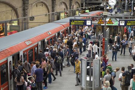 Passengers board a train at Hamburgs Main Railway Station (Hauptbahnhof), Hamburg, Germany