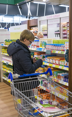 A customer in a Holland and Barrett health food store in a Tesco Supermarket Sajtókép