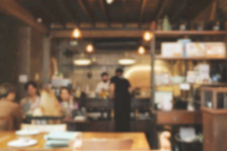 Blur coffee shop or cafe restaurant with abstract bokeh light image background. People in store Blur Background or design key visual layout