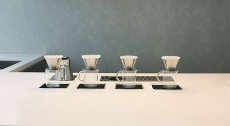 Counter making of espresso pouring from coffee slow bar.