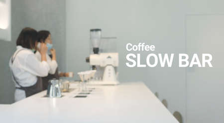 Blur people making of espresso pouring from coffee slow bar. Standard-Bild