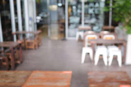 Blur Wood cozy cafe outdoor shop style background. cafe in store Blur Background or design key visual layout