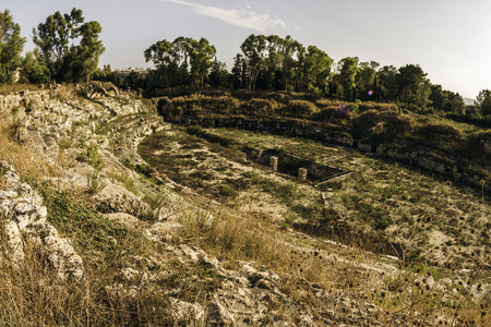 Ruins of an old Greek amphitheater in Syracuse, Italy