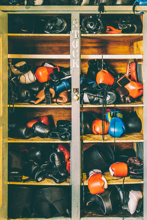 A locker at a boxing gym, filled with gear.