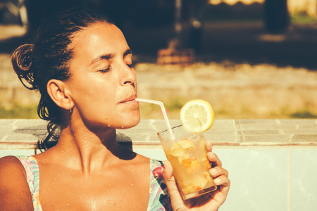 Woman drinking a cocktail in the summer Reklamní fotografie