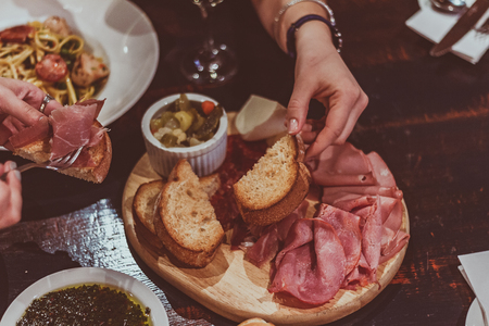 Shared rustic plate of cold cuts