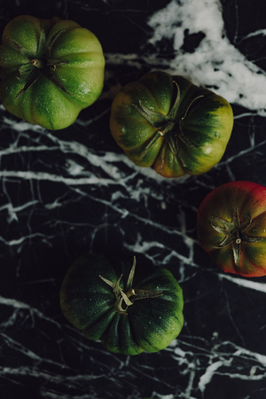 Moody tomatoes in a marble background