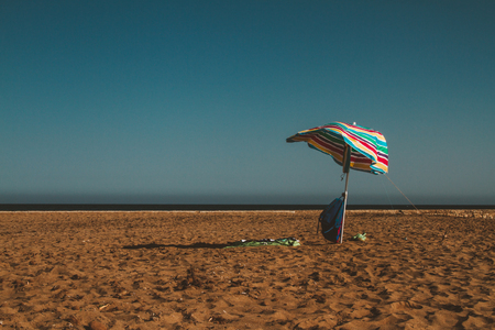 Umbrella left at a hot beach