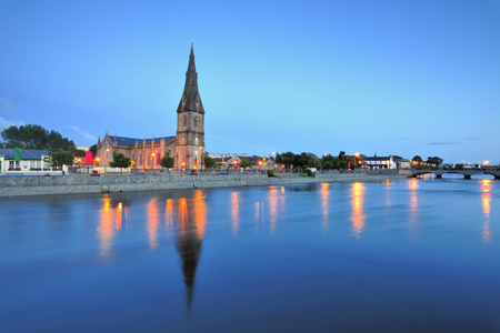 St.Muredach's Cathedral,Ballina,Co.Mayo, Ireland reflected in water of River Moy at twilight