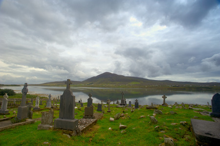 Kildownet old cemetery is located near the southern tip of Achill Stock Photo