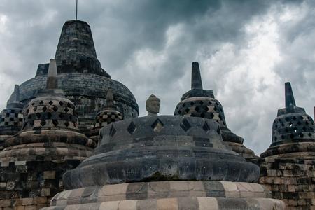 Perforated stupas and Buddha statue of Borobudur Temple, Yogyakarta, Indonesia Stock Photo