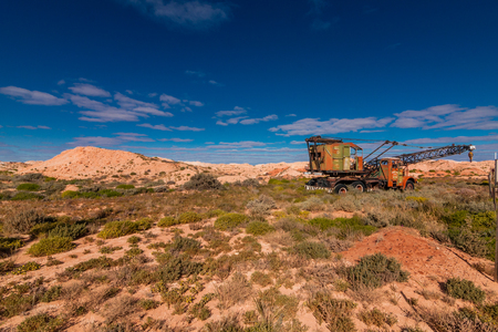 northern light: An abandoned truck crane in the opal dump near Coober Pedy, Australia Editorial