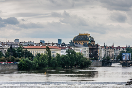 A cityscape of Prague with the National Theatre and LegionsBridge, Czech Republic