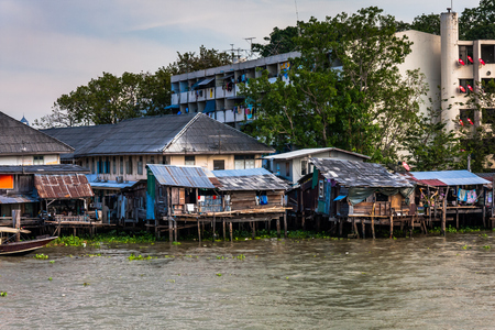 Poor dwellings on the Chao Phraya River near Bangkok, Thailand