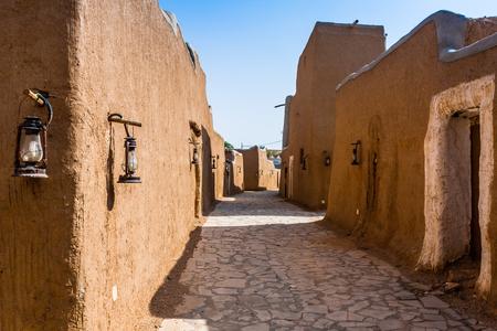 A narrow street in a traditional Arab mud brick village, Al Majmaah, Saudi Arabia