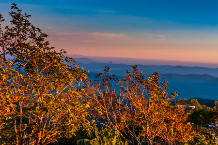 A scenic view from the Golden Rock Pagoda hill on the surrounding mountains at the sunset Stock Photo