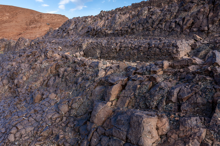 Lava outcrops on the slope of the Al Wahbah volcanic crater, Saudi Arabia