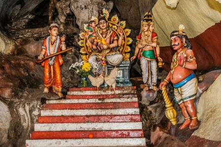 One of the altars with alive hens inside of the Batu Caves, Kuala Lumpur