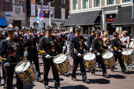 Military orchestra in traditional ceremonial uniform performing and marching in parade on the 2018 Veterans Day in The Hague