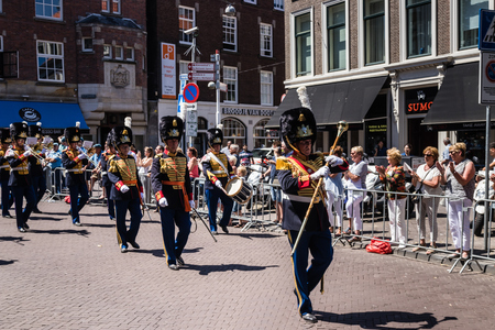 Military orchestra in traditional ceremonial uniform performing and marching at the parade on the 2018 Veterans Day in The Hague