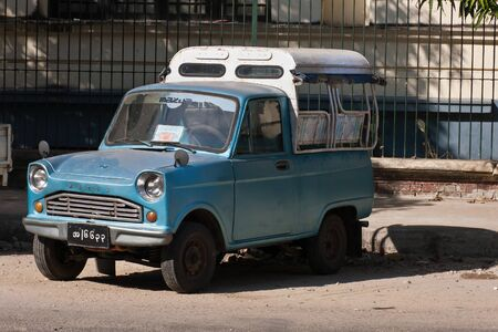 A vintage pick-up truck custom tuned for a taxi, Yangon, Myanmar Stockfoto