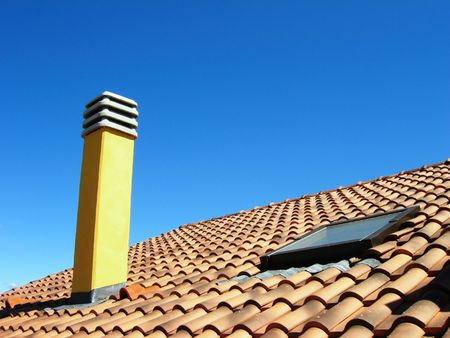 hearth and home: Chimney on roof on a clear summer day