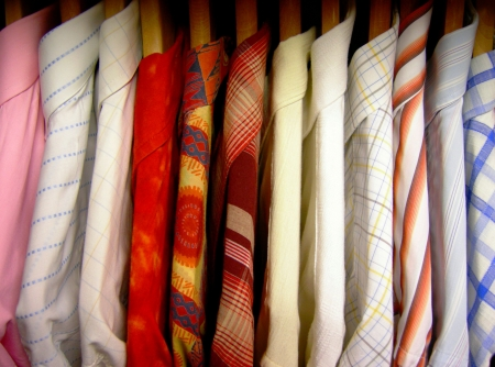 Colorful shirts made in Italy on wooden hangers Stock Photo - 2200667