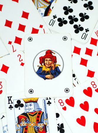Joker on playing cards background Editorial
